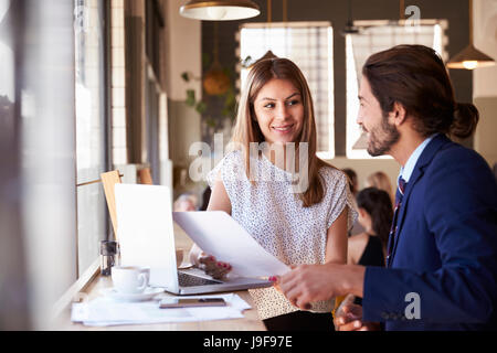 Two Businesspeople Having Informal Meeting In Coffee Shop - Stock Photo
