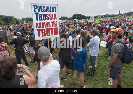 Washington, DC, USA. 3 June, 2017. Participants in the March for Truth rally near Washington Monument. listening - Stock Photo