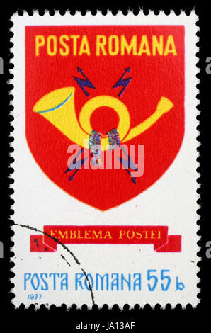 ROMANIA - CIRCA 1977: A stamp printed in Romania shows post emblem, circa 1977 - Stock Photo