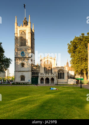 London, England - July 19, 2016: Tourists and commuters walk past St Margaret's Church in Parliament Square, Westminster. - Stock Photo