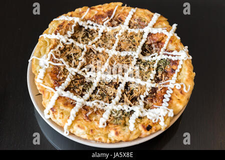okonomiyaki japanese pizza Osaka style - Stock Photo