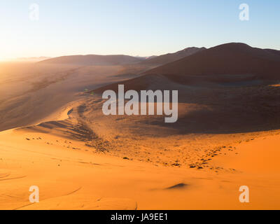 Sunrise at Dune 45 in the Sossusvlei area of the Namib Desert in Namibia. - Stock Photo