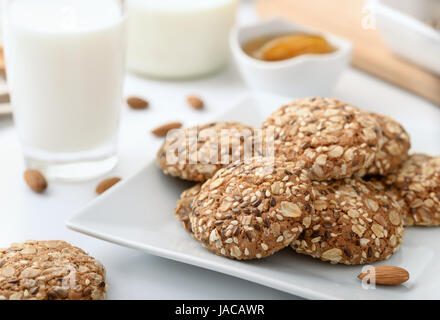 Still life with wholegrain biscuits milk and almonds - Stock Photo
