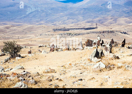 stone circle of Zorats Karer (Carahunge) - pre-history megalithic monument in Armenia - Stock Photo