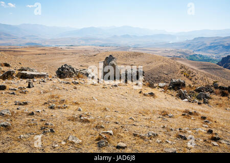 stone landscape of Zorats Karer (Carahunge) - pre-history megalithic monument in Armenia - Stock Photo