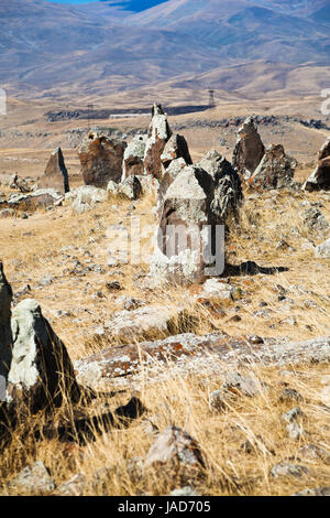 standing menhirs of Zorats Karer (Carahunge) - pre-history megalithic monument in Armenia - Stock Photo