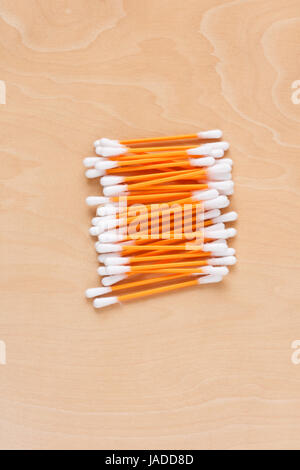 Ear sticks scattered on a table - Stock Photo