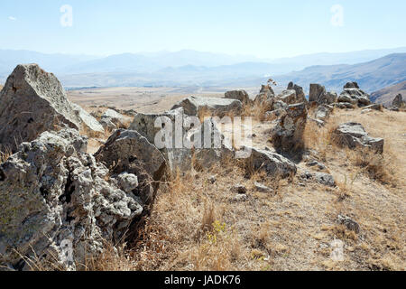 standing stones of Zorats Karer (Carahunge) - pre-history megalithic monument in Armenia - Stock Photo