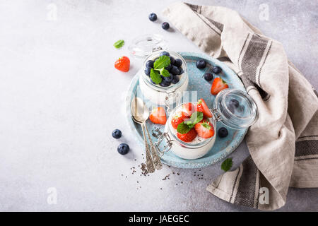 Chia seed pudding with berries in glass jar. Superfoods concept with copy space. Top view. - Stock Photo