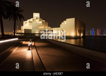 The Museum of Islamic Art in Doha Qatar, with a view beyond across the bay to the high rise skyscrappers of West - Stock Photo