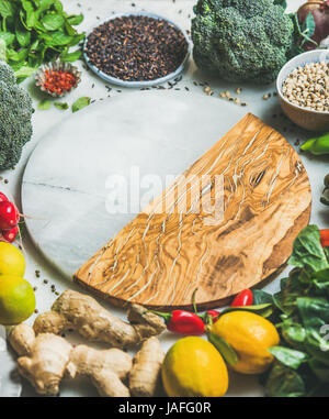 Clean eating healthy cooking ingredients. Vegetables, beans, grains, greens, fruit, spices over grey background, - Stock Photo