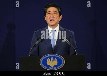 Japanese Prime Minister Shinzo Abe speaks at a press conference following a meeting with President Vladimir Putin - Stock Photo