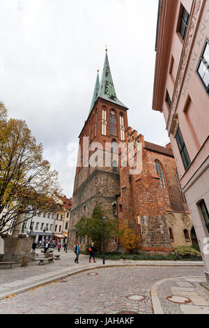BERLIN, GERMANY - OCTOBER 17: Nikolaikirche in Nicholas Quarter in Berlin on October 17, 2013. District Nikolaiviertel - Stock Photo
