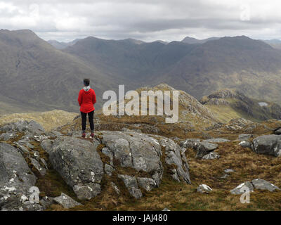 Walker on summit of Druim fada near Loch Hourn, Scotland - Stock Photo