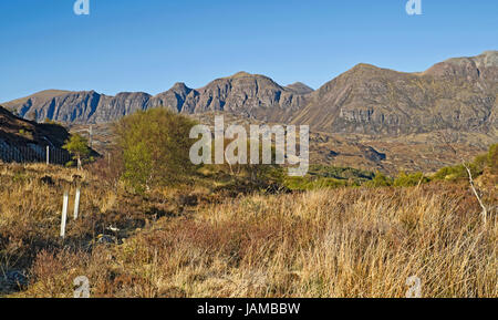 View of the west-facing ridge line of Quinag, seen in evening sunshine from moorland by the A837, North Coast 500, - Stock Photo