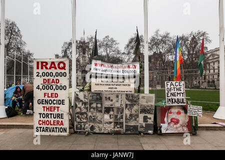 Placards at the peace camp of Brian Haw the long-term anti-war protester in Parliament Square, London, UK. - Stock Photo