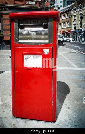A Franked Mail (business mail) Royal Mail Post Box in East London, UK. - Stock Photo