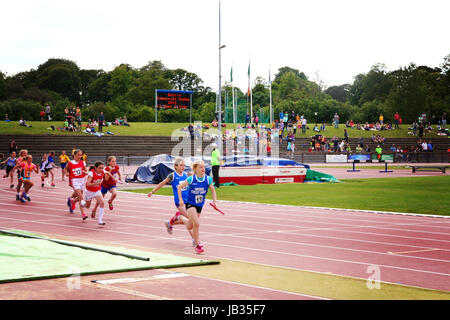 Children running a race at a track on an overcast day in Dublin Ireland - Stock Photo