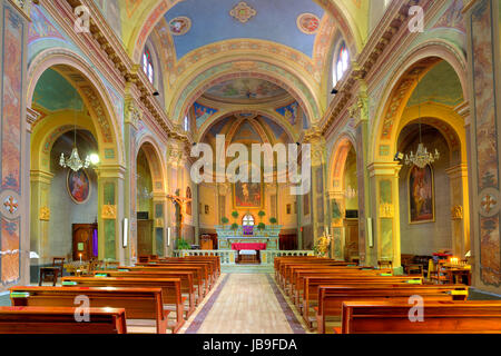 Interior view of small catholic church in town of Serralunga D'Alba in Piedmont, Northern Italy. - Stock Photo