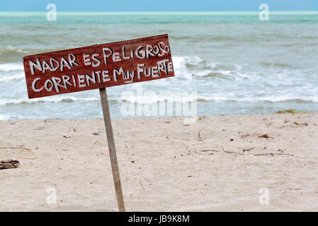 Sign in Spanish stating that it is dangerous to swim in Palomino, Colombia - Stock Photo
