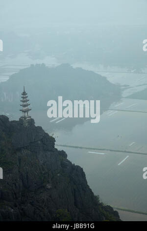View of temple, limestone karsts and rice paddies from Mua Cave Lookout, Trang An Landscape Complex (UNESCO World - Stock Photo