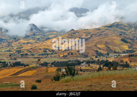 Clouds on the fields of Zumbahua in Ecuadorian Altiplano. Highland Andes near Quilotoa lagoon, South America - Stock Photo