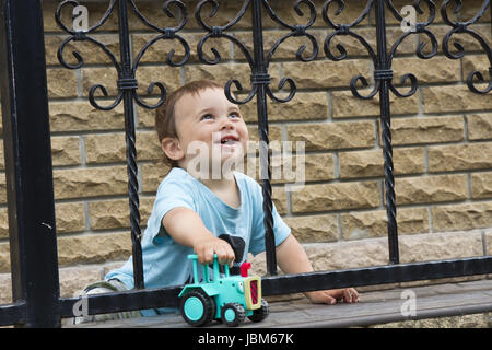 Little boy playing a tractor - Stock Photo