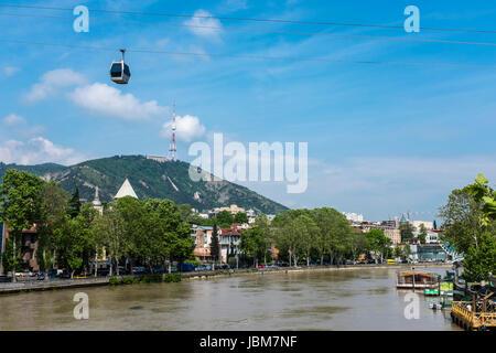 Aerial Tramway cable cars over Mtkvari River, Tbilisi, Georgia, Eastern Europe - Stock Photo