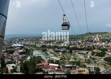 Aerial Tramway cable cars over central Tbilisi, Georgia, Eastern Europe - Stock Photo