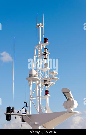 Antennas, radar, anemometer and other communication and navigation equipment on the mast of a ship. - Stock Photo