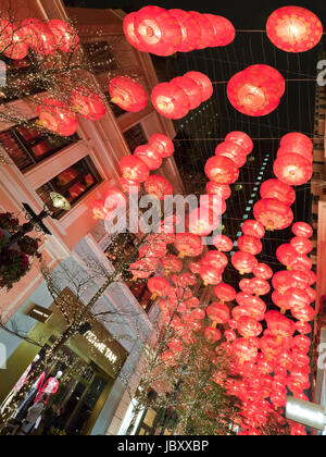 Vertical view of Chinese New Year decorations lit up at night at the controversial Lee Tung Street urban renewal - Stock Photo