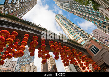 Horizontal perspective view of Chinese New Year decorations hanging up on Lee Tung Street in Hong Kong, China. - Stock Photo