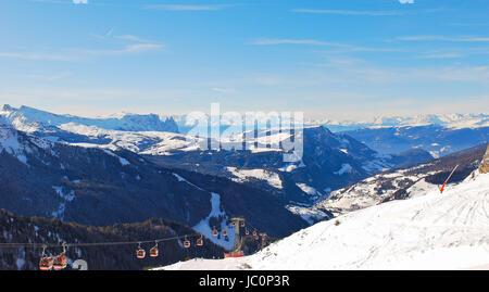 ski lift and panorama of Dolomites mountains in Val Gardena, Italy - Stock Photo