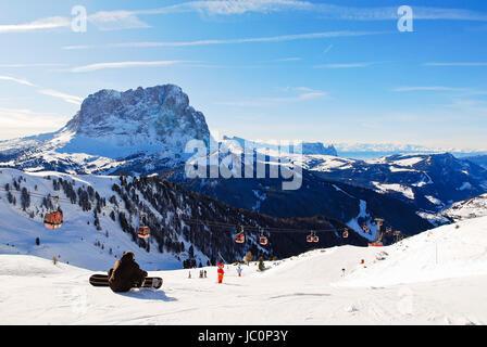 ski lift and view of Dolomites mountains in Val Gardena, Italy - Stock Photo