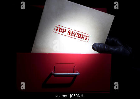Looking for top secret documents in a dark. - Stock Photo