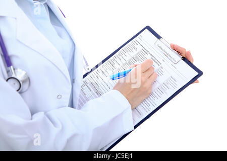 Close up of a female doctor filling up medical history form, just hands - Stock Photo