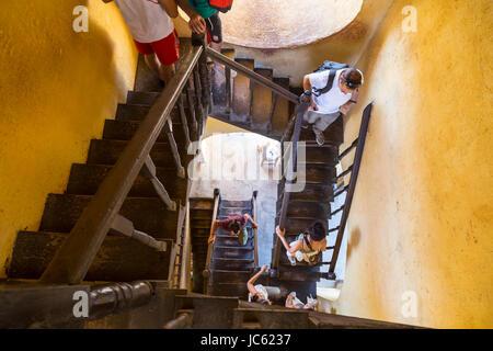 People in the stairway of San Francisco de Asis church, Trinidad, Cuba - Stock Photo