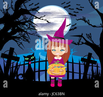 girl in witch costume holding pumpkin with candy - Stock Photo