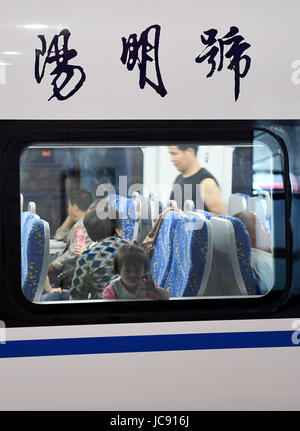 (170615) -- NINGBO, JUNE 15, 2017 (Xinhua) -- Passengers sit in a CRH6F train at Ningbo station in Ningbo City, - Stock Photo