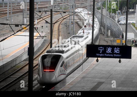 (170615) -- NINGBO, JUNE 15, 2017 (Xinhua) -- A CRH6F train pulls out of Ningbo station at Ningbo City, east China's - Stock Photo