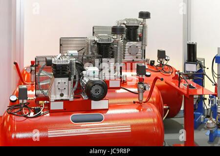 Air compressors in auto service garage - Stock Photo