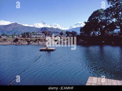Reportage Nepal 1980. Pokhara, transport in the Pewa-Tal lake and Annapurna range in the backgroundi - Stock Photo