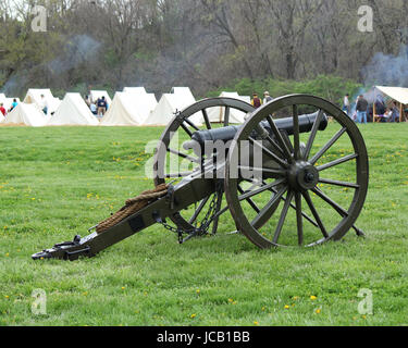 Civil War cannon at reenactment camp - Stock Photo