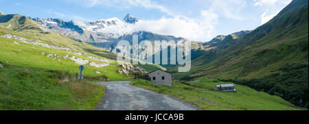 VILLE DES GLACIERS, FRANCE - AUGUST 27: Panoramic of chalets with Glacier Needles. The region is a stage at the - Stock Photo