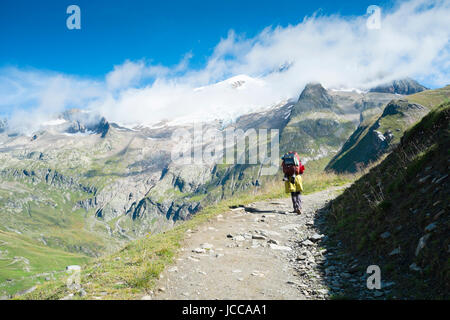 VILLE DES GLACIERS, FRANCE - AUGUST 27: Hiker walking towards Glacier Needles. The region is a stage at the Mont - Stock Photo