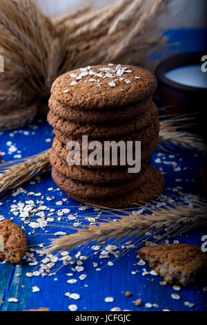 Oatmeal cookies on blue wooden background.  Towel of oat cookies - Stock Photo