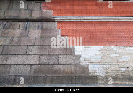 Three variants of facing the walls of the Peter and Paul Fortress with brick, limestone and granite - Stock Photo