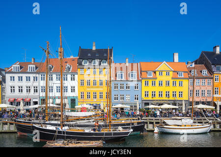 Copenhagen, Denmark - May 1, 2017: Nyhavn is a 17th-century waterfront, canal and entertainment district in Copenhagen, - Stock Photo