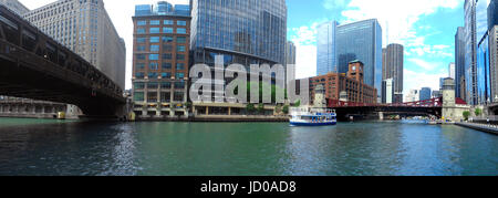 Looking east on the Chicago River along the River Walk towards La Salle Street from the Wells Street Bridge. - Stock Photo