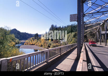 RUSSIAN RIVER CROSSING BRIDGE Rustic metal girder bridge over the Russian River with typical American red pick-up - Stock Photo